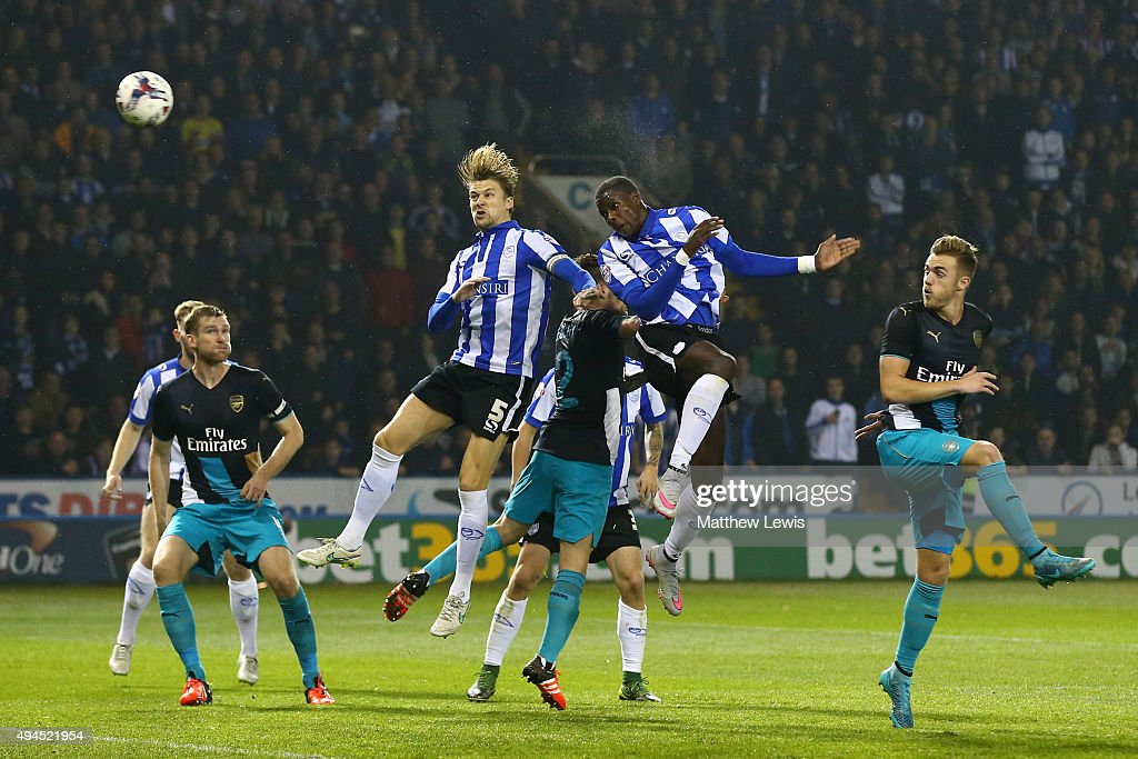 Lucas Joao (2nd R) of Sheffield Wednesday rises above the Arsenal defence to score his team's second goal during the Capital One Cup fourth round match between Sheffield Wednesday and Arsenal at Hillsborough Stadium on October 27, 2015 in Sheffield, England.
