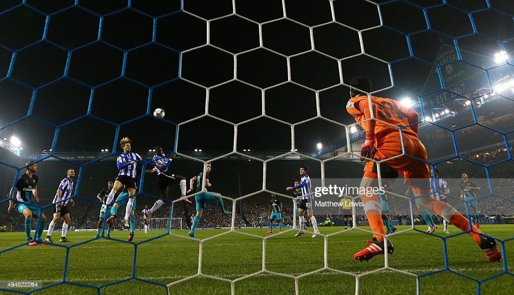 Lucas Joao of Sheffield Wednesday rises above the Arsenal defence to score his team's second goal during the Capital One Cup fourth round match between Sheffield Wednesday and Arsenal at Hillsborough Stadium on October 27, 2015 in Sheffield, England.