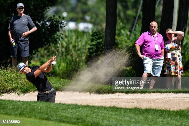 Lucas Kim of Canada hits a bunker shot on the second hole during the final round of the Mackenzie Investments Open at Club de Golf Les Quatre...
