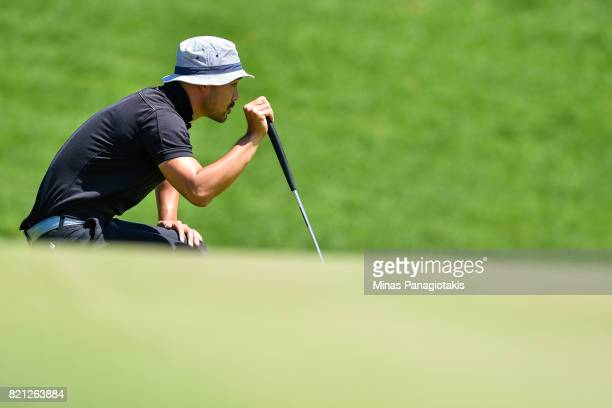 Lucas Kim of Canada lines up a putt on the third hole during the final round of the Mackenzie Investments Open at Club de Golf Les Quatre Domaines on...