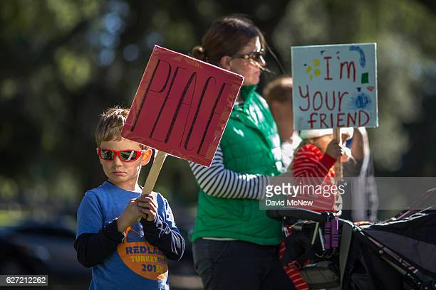 Lucas Kronberg his mother Bethany and sister Ruth 20 months hold signs during a Walk for Peace at the University of Redlands sponsored by the Middle...