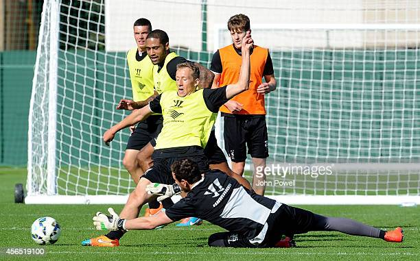Lucas Leiva and Danny Ward of Liverpool in action during a training session at Melwood Training Ground on October 2 2014 in Liverpool England