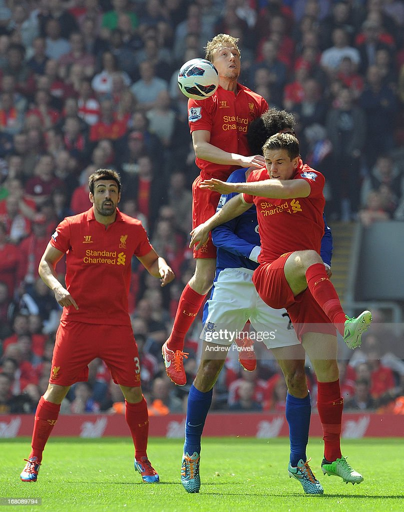 Lucas Leiva (L) and Jordan Henderson (R) of Liverpool contain Marouane Fellaini (C) of Everton during the Barclays Premier League match between Liverpool and Everton at Anfield on May 5, 2013 in Liverpool, England.