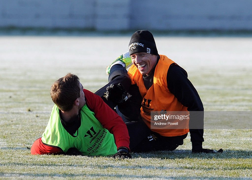 <a gi-track='captionPersonalityLinkClicked' href=/galleries/search?phrase=Lucas+Leiva+-+Defensive+Midfielder+-+Born+1987&family=editorial&specificpeople=4114250 ng-click='$event.stopPropagation()'>Lucas Leiva</a> and <a gi-track='captionPersonalityLinkClicked' href=/galleries/search?phrase=Jordan+Henderson&family=editorial&specificpeople=4940390 ng-click='$event.stopPropagation()'>Jordan Henderson</a> of Liverpool during a training session at Melwood Training Ground on December 13, 2012 in Liverpool, England.