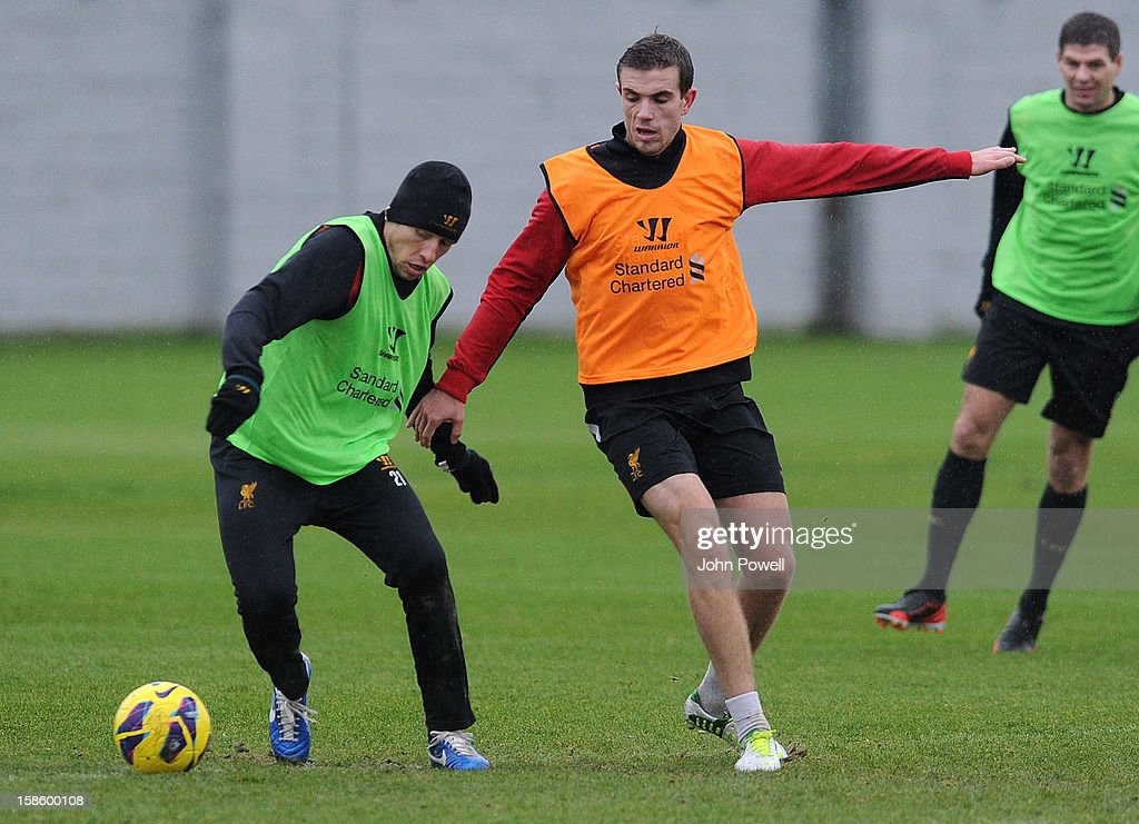 Lucas Leiva (L) and Jordan Henderson of Liverpool in action during a training session at Melwood Training Ground on December 20, 2012 in Liverpool, England.