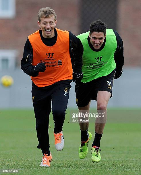 Lucas Leiva and Martin Kelly of Liverpool in action during a training session at Melwood Training Ground on December 13 2013 in Liverpool England