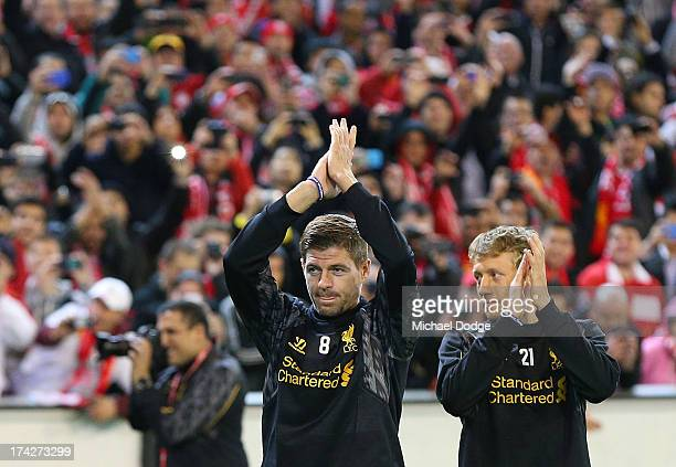 Lucas Leiva and Steven Gerrard clap the Liverpool fans when entering the field during a Liverpool FC training session at Melbourne Cricket Ground on...