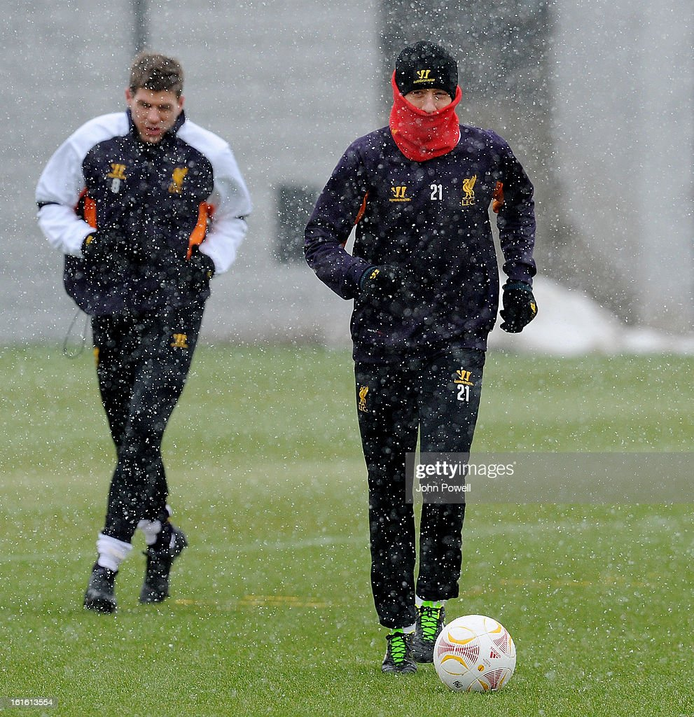Lucas Leiva and Steven Gerrard of Liverpool in action during a training session at Melwood Training Ground on February 13, 2013 in Liverpool, England.