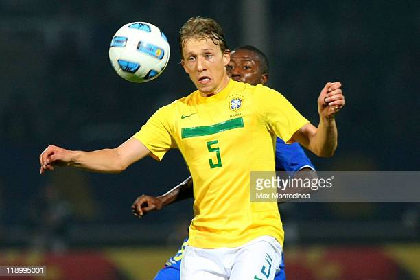 Lucas Leiva from Brazil fights for the ball with Édison Méndez from Ecuador during a match between Brazil and Ecuador as part of the Group B of the...