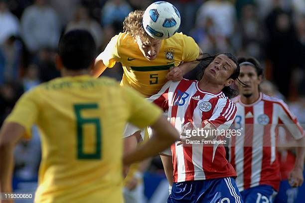 Lucas Leiva from Brazilfighst for the ball with Enrique Vera during a match between Brazil and Paraguay as part of the Quarter Finals of Copa America...