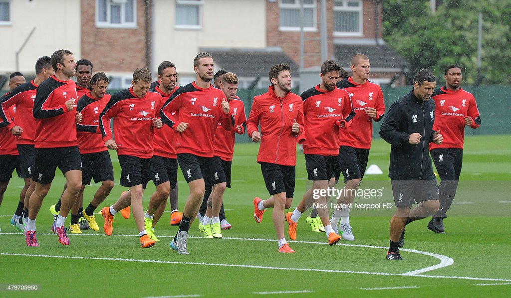 Lucas Leiva, Jordan Henderson, Adam Lallana and the rest of the squad during the warm up as Liverpool players return for pre-season training at Melwood Training Ground on July 6, 2015 in Liverpool, England.