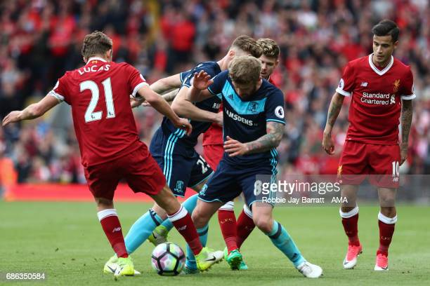 Lucas Leiva of Liverpool and Adam Clayton of Middlesbrough during the Premier League match between Liverpool and Middlesbrough at Anfield on May 21...