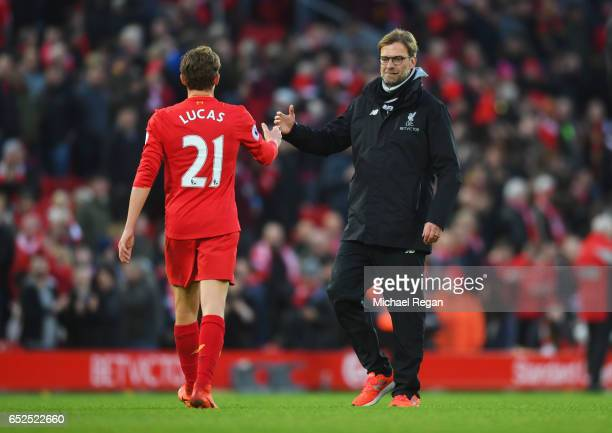 Lucas Leiva of Liverpool and Jurgen Klopp Manager of Liverpool embrace after the Premier League match between Liverpool and Burnley at Anfield on...