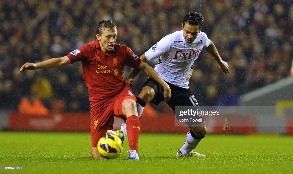 Lucas Leiva of Liverpool and Kieran Richardson of Fulham compete during the Barclays Premier League match between liverpool and Fulham at Anfield on December 22, 2012 in Liverpool, England.