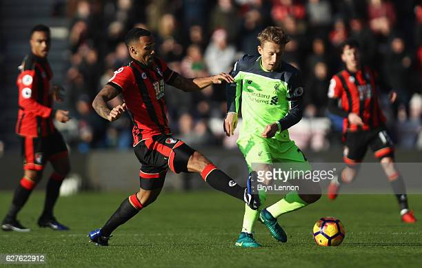 Lucas Leiva of Liverpool battles with Callum Wilson of AFC Bournemouth during the Premier League match between AFC Bournemouth and Liverpool at...