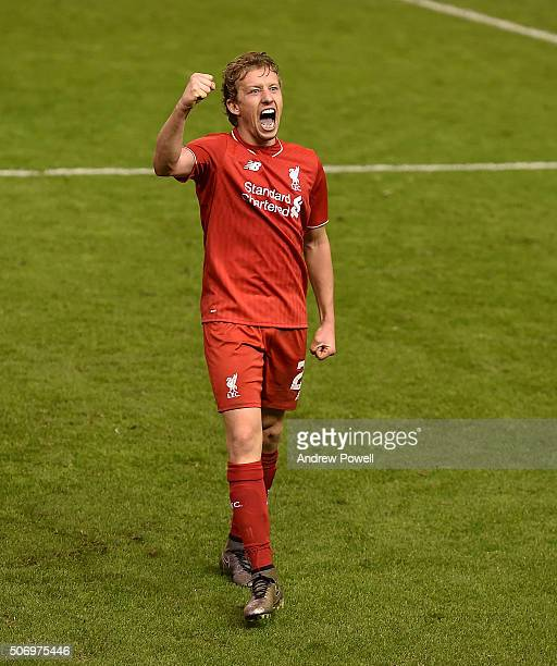 Lucas Leiva of Liverpool celebrates the win at the end of the Capital One Cup Semi Final Second Leg between Liverpool and Stoke City at Anfield on...