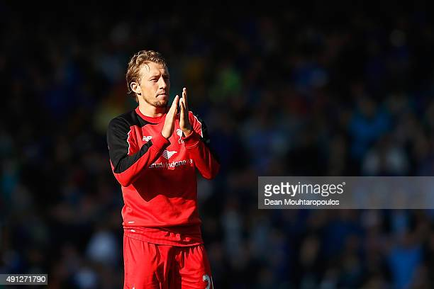 Lucas Leiva of Liverpool claps the away support after the Barclays Premier League match between Everton and Liverpool at Goodison Park on October 4...