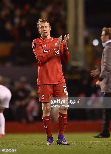 Lucas Leiva of Liverpool claps to the fans at the end of the UEFA Europa League Round of 32 second leg match between Liverpool and FC Augsburg at...