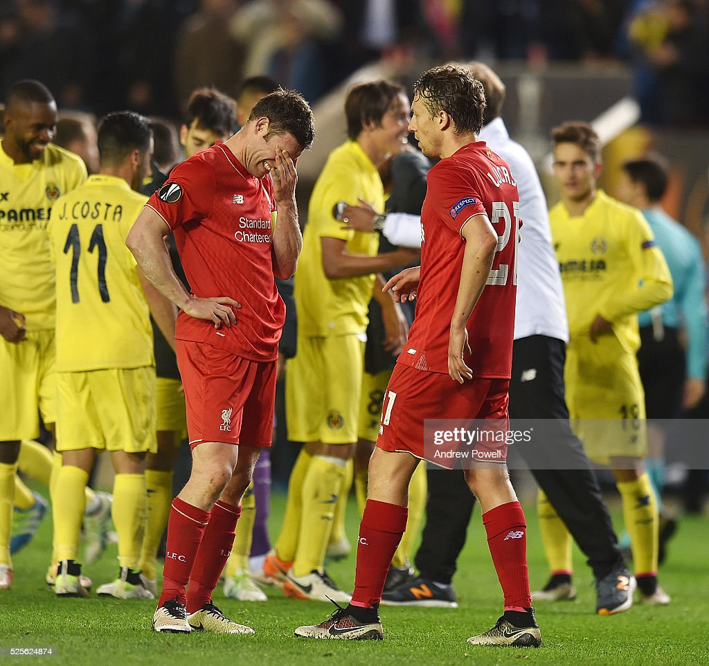 Lucas Leiva of Liverpool comforts James Milner of Liverpool at the end of the UEFA Europa League Semi Final: First Leg match between Villarreal CF and Liverpool on April 28, 2016 in Villarreal, Spain.