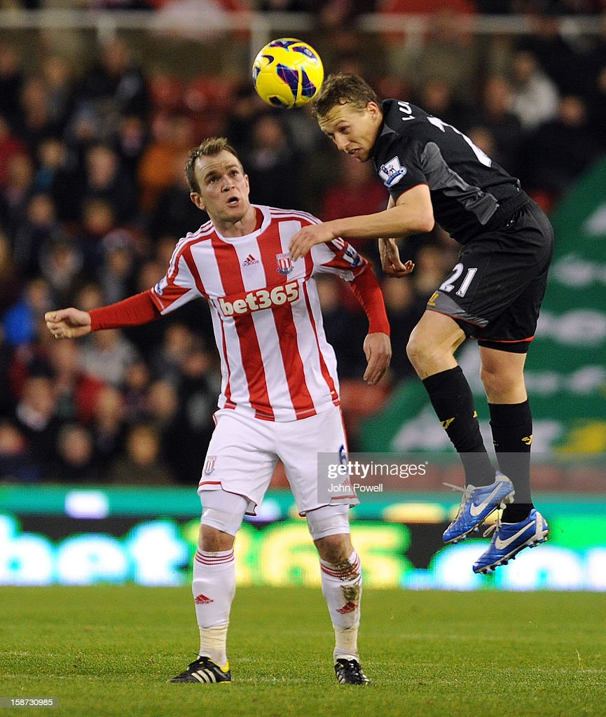 Lucas Leiva of Liverpool goes up with Glenn Whelan of Stoke City during the Barclays Premier League match between Stoke City and Liverpool at Britannia Stadium on December 26, 2012 in Stoke on Trent, England.