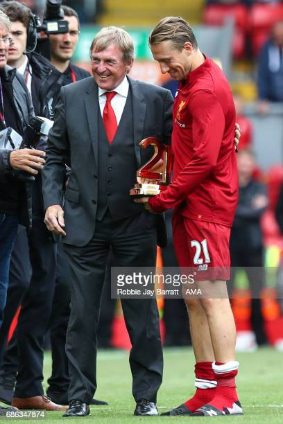 Lucas Leiva of Liverpool receives an award from Kenny Dalglish during the Premier League match between Liverpool and Middlesbrough at Anfield on May...