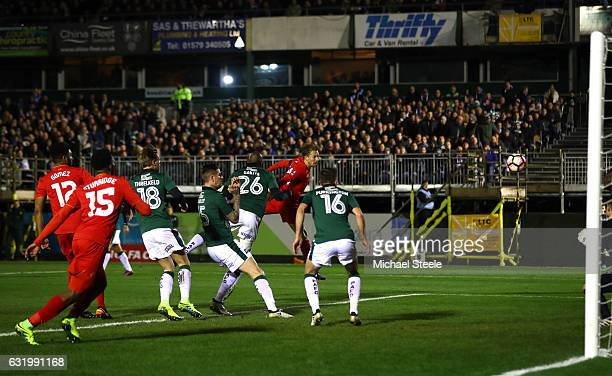 Lucas Leiva of Liverpool scores the opening goal with a header during The Emirates FA Cup Third Round Replay match between Plymouth Argyle and...