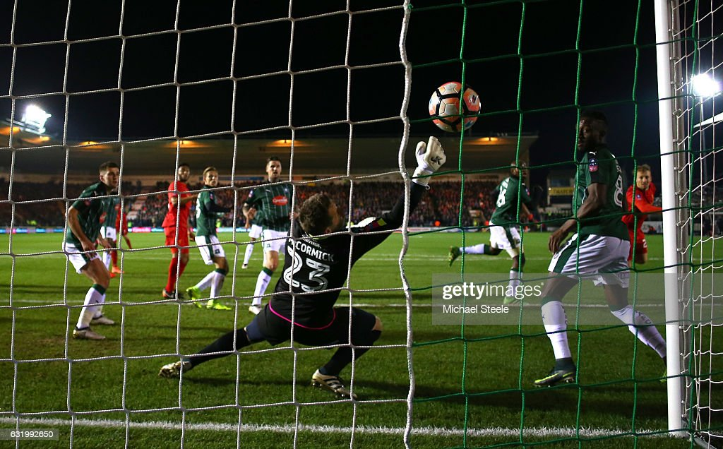 Lucas Leiva of Liverpool scores the opening goal with a header past Luke McCormick of Plymouth Argyle during The Emirates FA Cup Third Round Replay match between Plymouth Argyle and Liverpool at Home Park on January 18, 2017 in Plymouth, England.