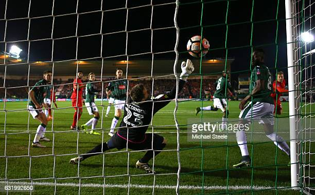 Lucas Leiva of Liverpool scores the opening goal with a header past Luke McCormick of Plymouth Argyle during The Emirates FA Cup Third Round Replay...