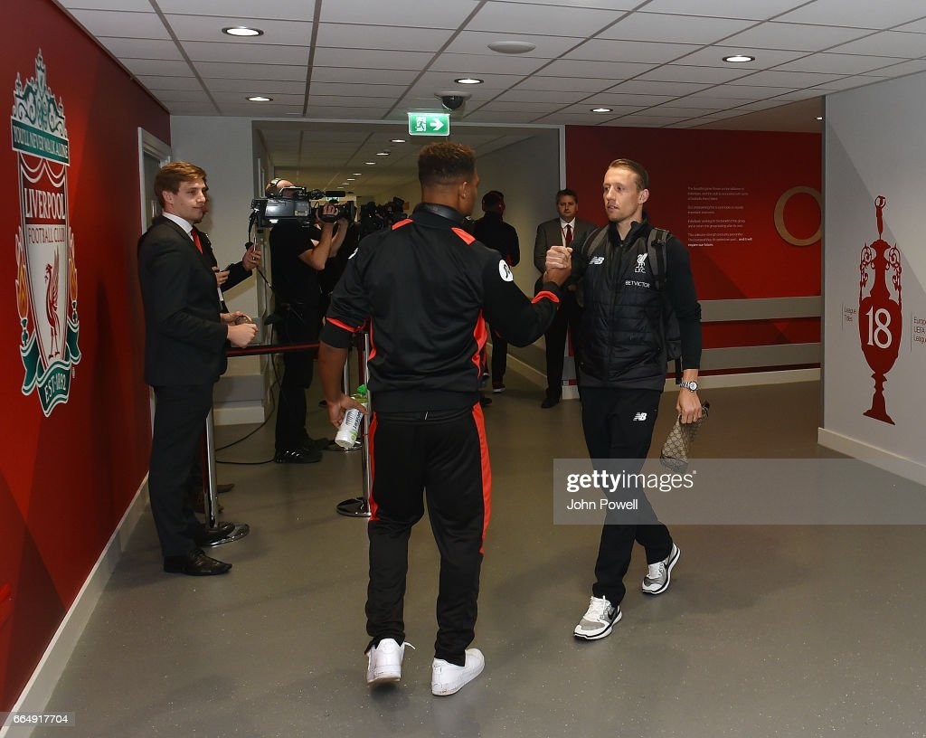 Lucas Leiva of Liverpool shakes hands with Jordon Ibe of AFC Bournemouth before the Premier League match between Liverpool and AFC Bournemouth at Anfield on April 5, 2017 in Liverpool, England.