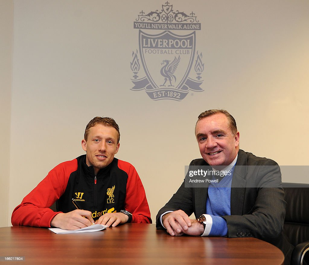 Lucas Leiva of Liverpool signs a long term extension to his contract with Ian Ayre managing director of Liverpool at Melwood Training Ground on April 10, 2013 in Liverpool, England.