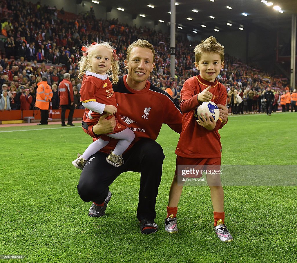 Lucas Leiva of Liverpool with his family at the end of the Barclays Premier League match between Liverpool and Chelsea at Anfield on May 11, 2016 in Liverpool, England.