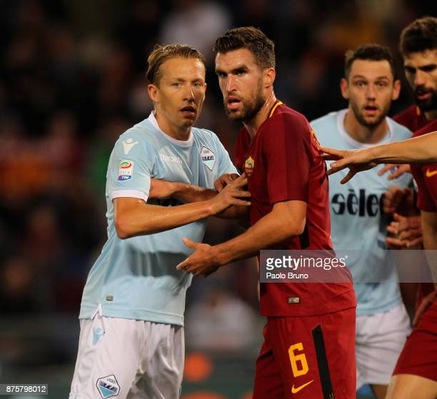 Lucas Leiva of SS Lazio competes for the ball with Kevin Strootman of AS Roma during the Serie A match between AS Roma and SS Lazio at Stadio...