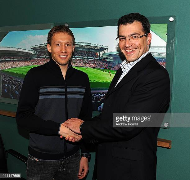 Lucas Leiva shakes hands with Director of Football for Liverpool Damien Comolli after signing a new Liverpool FC contract at Melwood Training Ground...