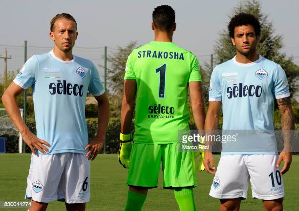 Lucas Leiva Thomas Strakosha and Felipe Anderson of SS Lazio wear the new SS Lazio shirt during the unveiling of the new shirt for the Italian...