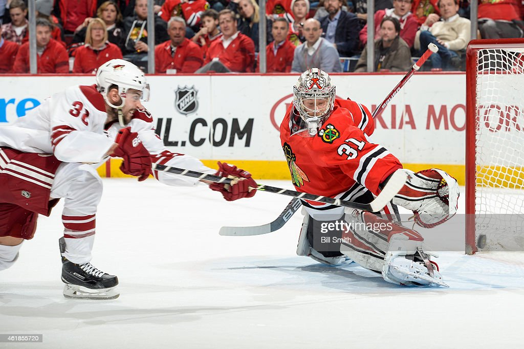 Lucas Lessio of the Arizona Coyotes scores on goalie Antti Raanta of the Chicago Blackhawks in the second period during the NHL game at the United...