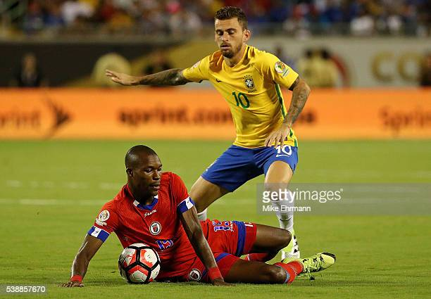 Lucas Lima of Brazil and James Marcelin of Haiti fight for the ball during a Group B match of the 2016 Copa America Centenario at Camping World...