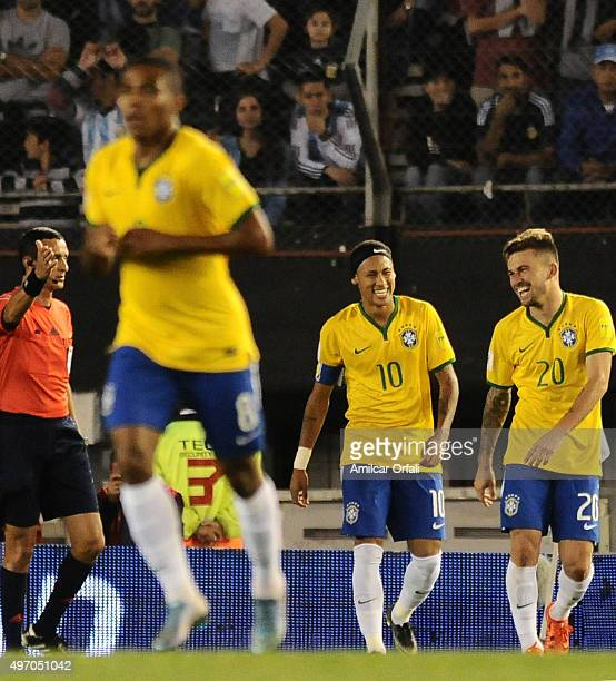 Lucas Lima of Brazil celebrates with teammate Neymar Jr after scoring the first goal of his team during a match between Argentina and Brazil as part...