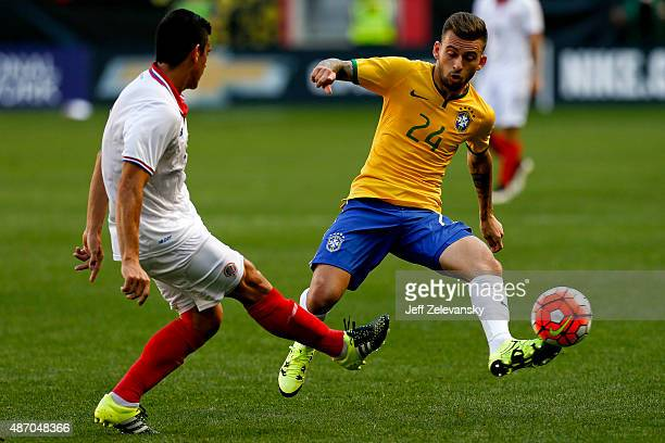 Lucas Lima of Brazil defends Johnny Acosta of Costa Rica during their match at Red Bull Arena on September 5 2015 in Harrison New Jersey