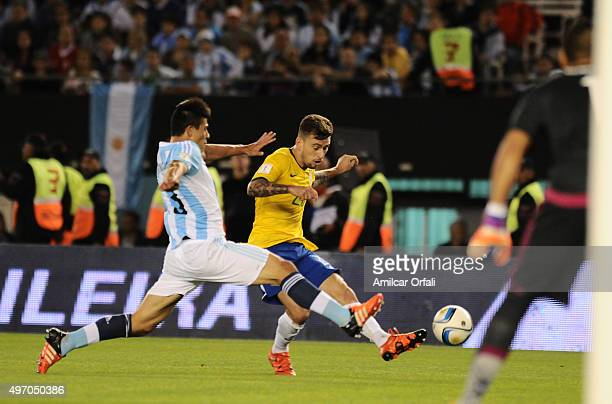 Lucas Lima of Brazil kicks the ball as Facundo Roncaglia of Argentina defends during a match between Argentina and Brazil as part of FIFA 2018 World...
