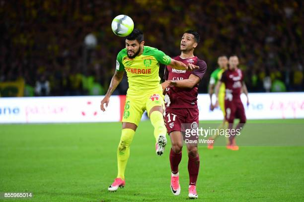 Lucas Lima of Nantes and Matthieu Dossevi of Metz during the Ligue 2 match between Paris FC and Nimes on September 29 2017 in Paris France
