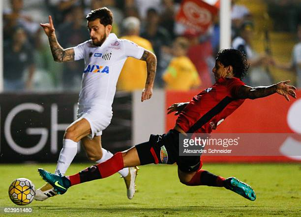 Lucas Lima of Santos and Victor Ramos of Vitoria in action during the match between Santos and Vitoria for the Brazilian Series A 2016 at Vila...