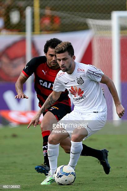 Lucas Lima of Santos battles for the ball during the match between Vitoria and Santos as part of Brasileirao Series A 2014 at Estadio Manoel Barradas...