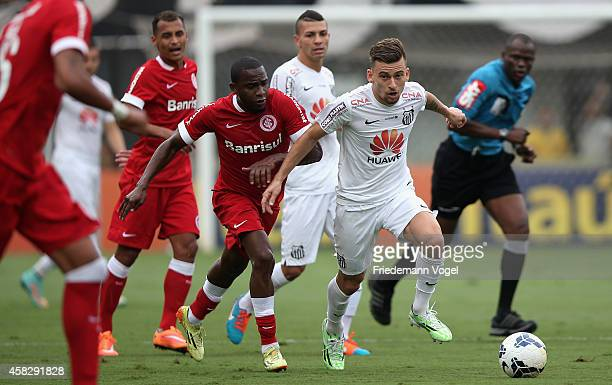 Lucas Lima of Santos fights for the ball with Willians of Internacional during the match between Santos and Internacional for the Brazilian Series A...