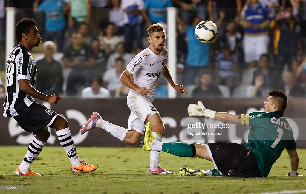 Lucas Lima of Santos shoots for a goal during a match between Santos and Figueirense of Brasileirao Series A 2014 at Vila Belmiro Stadium on...