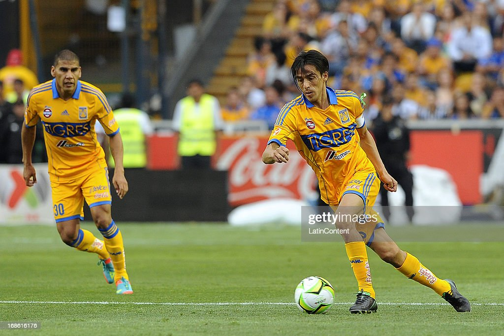 Lucas Lobos of Tigres drives the ball during the match between Tigres and Monterrey as part of the Clausura Tournament 2013 on May 11, 2013 in Monterrey, Mexico.