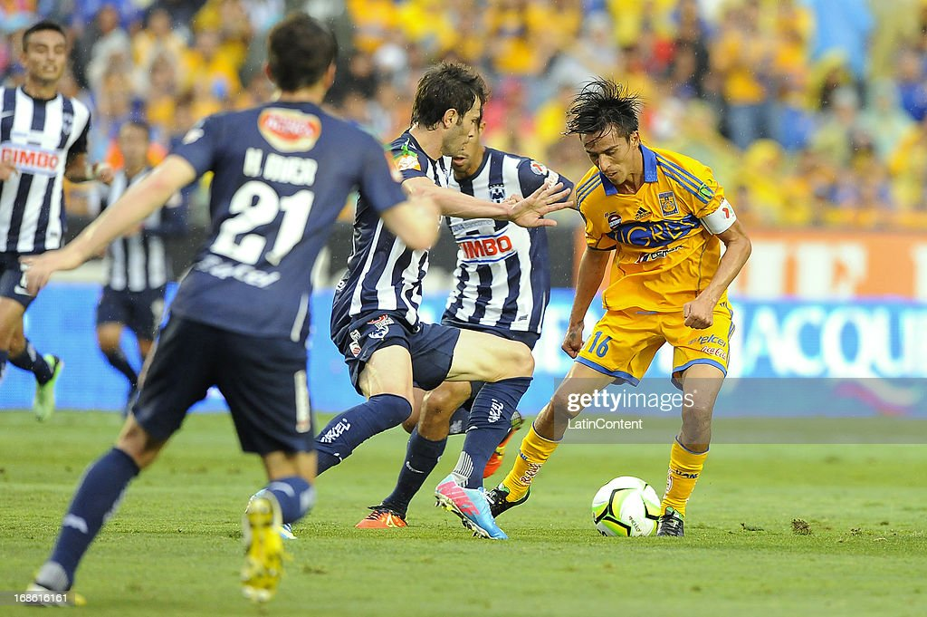 Lucas Lobos of Tigres fights for the ball during the match between Tigres and Monterrey as part of the Clausura Tournament 2013 on May 11, 2013 in Monterrey, Mexico.