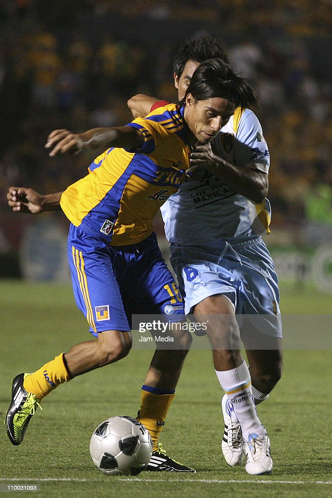 Lucas Lobos (L) of Tigres struggles for the ball with Jaime Correa (R) of San Luis during the Clausura 2011 Tournament in the Mexican Football League at Universitary Stadium on March 12, 2011 in Monterrey, Mexico.