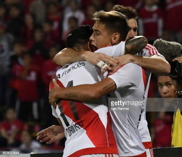 Lucas Martinez of River Plate celebrates with teammate Sebastian Driussi after scoring the third goal of his team during a group stage match between...