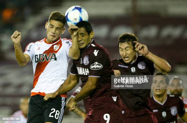 Lucas Martinez Quarta of River Plate fights for the ball with Jose Sand of Lanus during a match between Lanus and River Plate as part of Torneo...