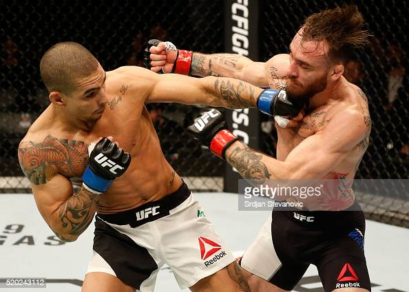 Lucas Martins punches Rob Whiteford in their featherweight bout during the UFC Fight Night event at the Arena Zagreb on April 10 2016 in Zagreb...